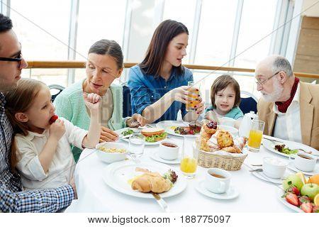 Big family of three generations having breakfast in restaurant
