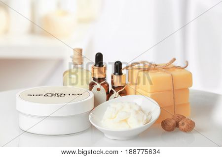Composition of Shea butter with cosmetic products on table