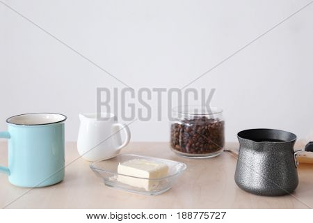 Composition with ingredients for bulletproof coffee on table