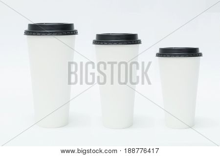 Three sizes blank take away coffee cups with black lid isolated on white background