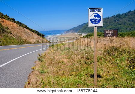 Tsunami warning zone road sign at Redwood National Park entrance
