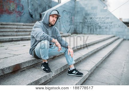 Dance performer sitting on the steps, urban style