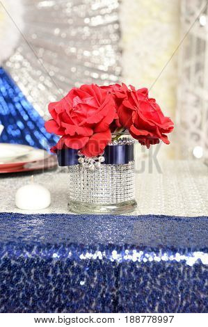 Red roses in elegant vase on sequence table