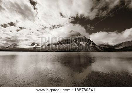 Mountains and forest reflection at Bow Lake with fog in Banff National Park, Canada.