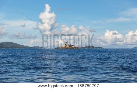 travel, tourism and seascape concept - view to indian ocean and seychelles islands