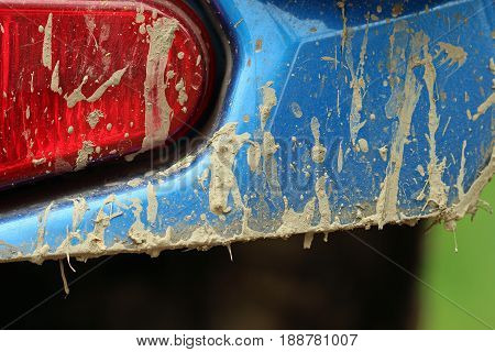 Rear close up view of a muddy all terrain vehicle.