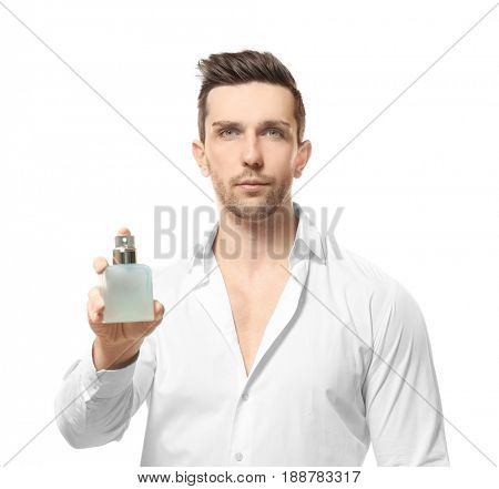 Handsome man using perfume on white background