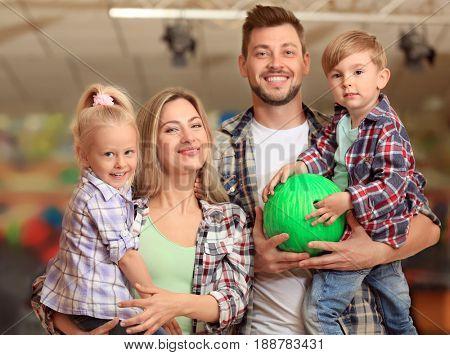Family having fun at bowling club