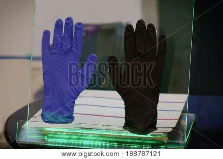 Latex gloves on glass display case
