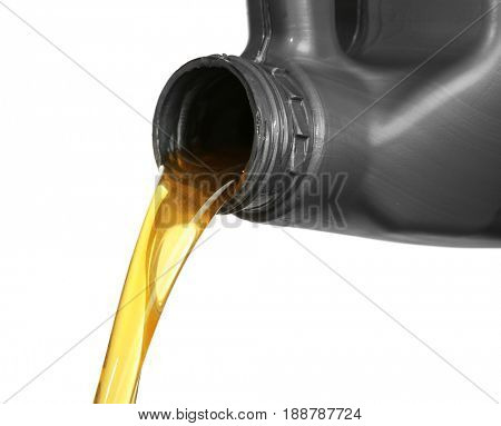 Engine oil pouring from canister, isolated on white