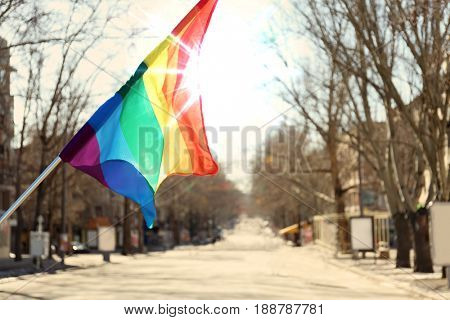 Gay flag outdoors. Concept of sexual minority
