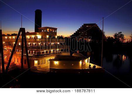 SACRAMENTO, CALIFORNIA, USA - November 14, 2009: Guests dining on the Delta King riverboat on the Sacramento River at sunset
