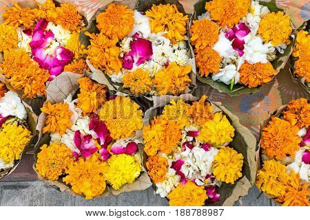 Flowers in banana leaves ready for a puja in India