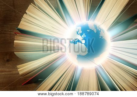 Globe and books on wooden background. World literature concept