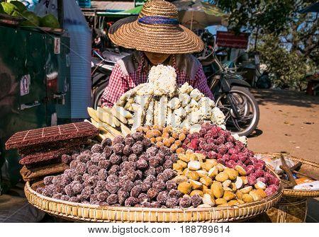 BAGAN, MYANMAR-MARCH 9, 2017: Street vendor selling sweet pastries in the  Old Bagan on March 9, 2017, Myanmar.(Burama)