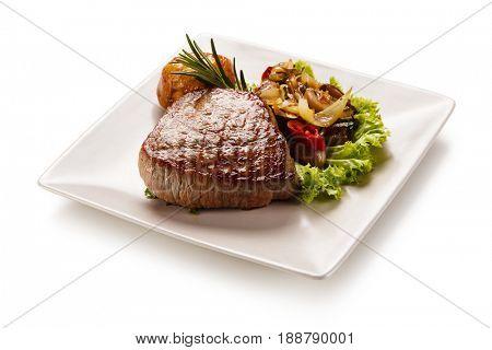 Grilled beefsteak with mushrooms