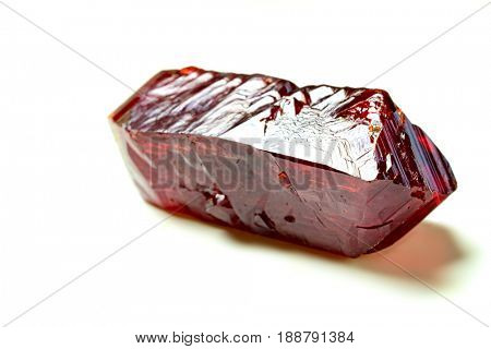 Red natural Geology crystals on white background. Red blood salt  Sodium ferrocyanide crystals