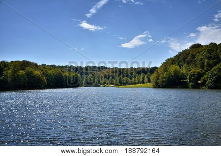 Beautiful lake between green hills in a sunny day