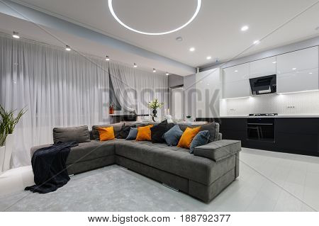 Modern white kitchen and living room