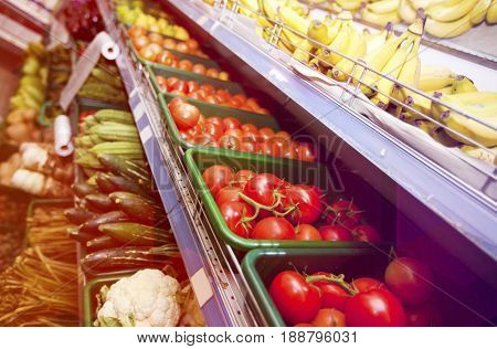 Various vegetables and fruits on display in supermarket