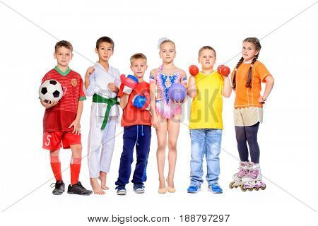 Sports and activities for children. Group of joyful boys and a girls engaged in various sports posing together. Education. Isolated over white background.