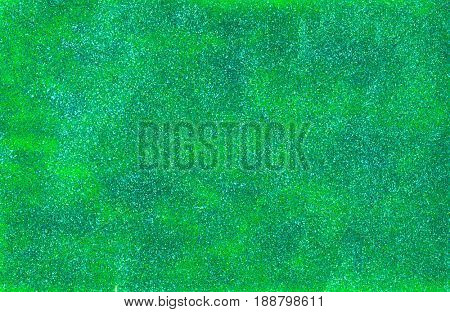 Background made of green glitter nail polish and lime green foam