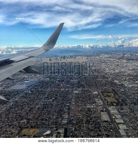great Image Of airplane wing and Los Angeles below