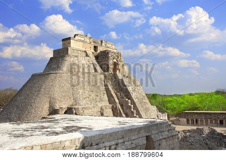Ancient Mayan pyramid of the Magician in Uxmal with god Chaac masks (god of rain), royal complex, Yucatan, Mexico. UNESCO world heritage site