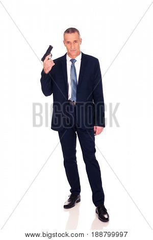Serious mafia agent with handgun