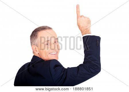 Back view businessman pointing upwards