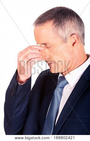 Businessman suffering from sinus pain