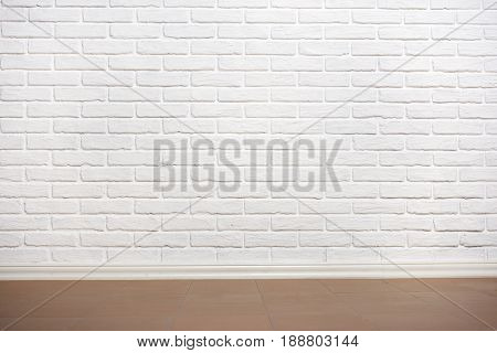 white brick wall with tiled floor, abstract background photo