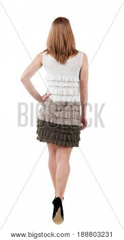 back view of going  woman  in  dress. beautiful girl in motion.  backside view of person. Isolated over white background. Rear view people collection.