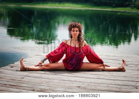 young woman practice yoga outdoor by the lake healthy lifestyle concept
