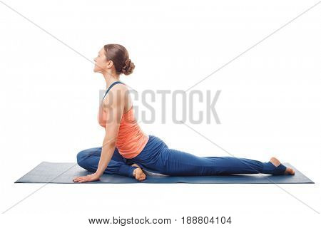 Woman doing yoga asana Eka pada kapotasana - one-legged pigeon pose posture isolated on white