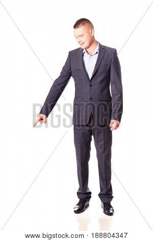 Young businessman pointing down