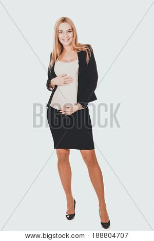 Pregnant woman in business suit.