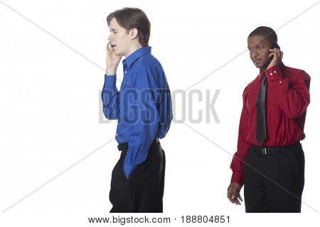 Businessmen talking on cell phones
