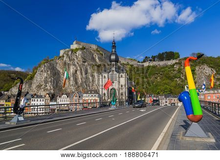 Saxophone statue in Dinant - Belgium - architecture background