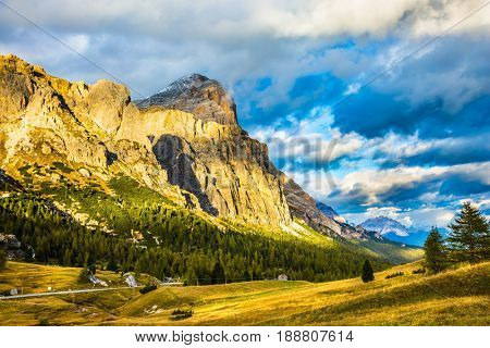 Last sunny day of fall. Travel in the Dolomites. To pass Faltsarego approaching snowstorm. Concept of active and extreme tourism