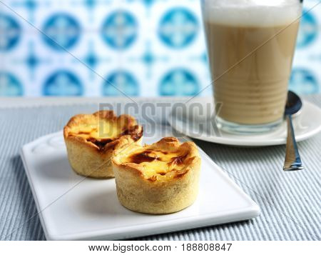 Portuguese egg tart pastry Pastel de nata with a cup of coffee latte