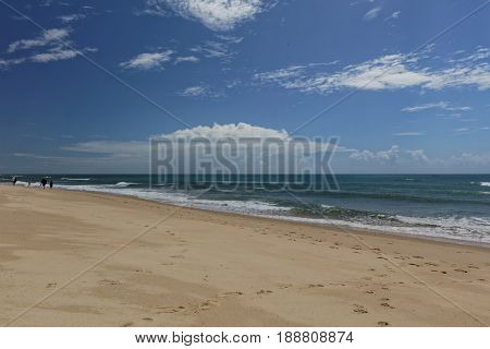People on the sandy beach of Culatra Island in Ria Formosa Natural Park, Portugal