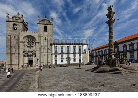 PORTO, PORTUGAL - MAY 8, 2017: People in front of the Porto Cathedral. Built in 1737, it is one of the most important local Romanesque monuments