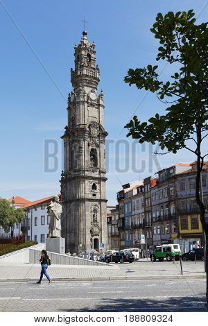 PORTO, PORTUGAL - MAY 8, 2017: People at the bell tower of Clerigos church. The church was built in 1732-1750s by Italian architect Nicolau Nasoni