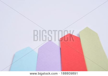 Picture of business graphics diagrama isolated over grey table background.