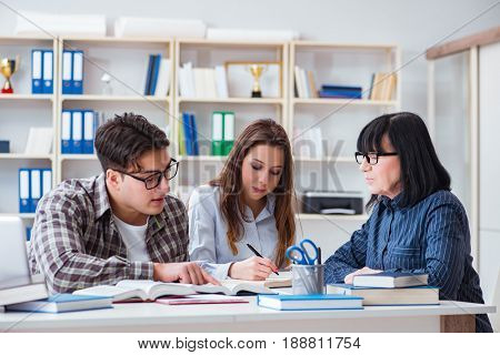 Young student and teacher during tutoring lesson