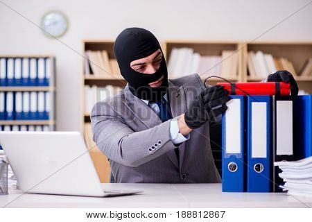 Criminal businessman with balaclava with dynamite
