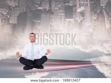 Digital composite of up side down city. meditating under the city