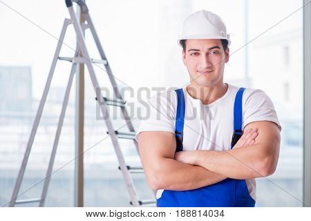 Young worker with safety helmet hardhat