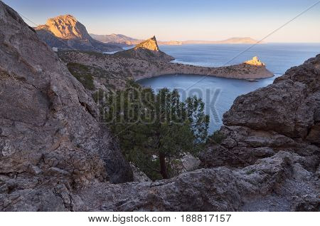 Landscape with a seaside resort. View from the mountain to the sea, bays and capes. Beautiful light of the evening sun. Crimea peninsula. Ukraine, Europe